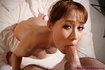 Breasty Obana Urumi strips and sucks thick cock taking facial