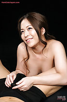 Kneeling naked between his legs looking up with a beaming smile Asakura Mint fondles his cock through his shorts