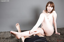 Aya Kisaki seated nude bare feet stretched out across prone man