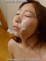 Thick cum on her cheek face glazed with cum