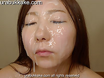 Rina with her face drenched in thick bukkake cum